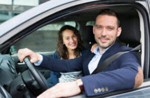 Man-and-woman-ready-to-drive-dodge-dealer-dick-huvaeres-richmond-chrysler-dodge-jeep-ram-richmond-mi